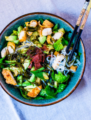 Sea vegetables chicken salad in a bowl with chopsticks
