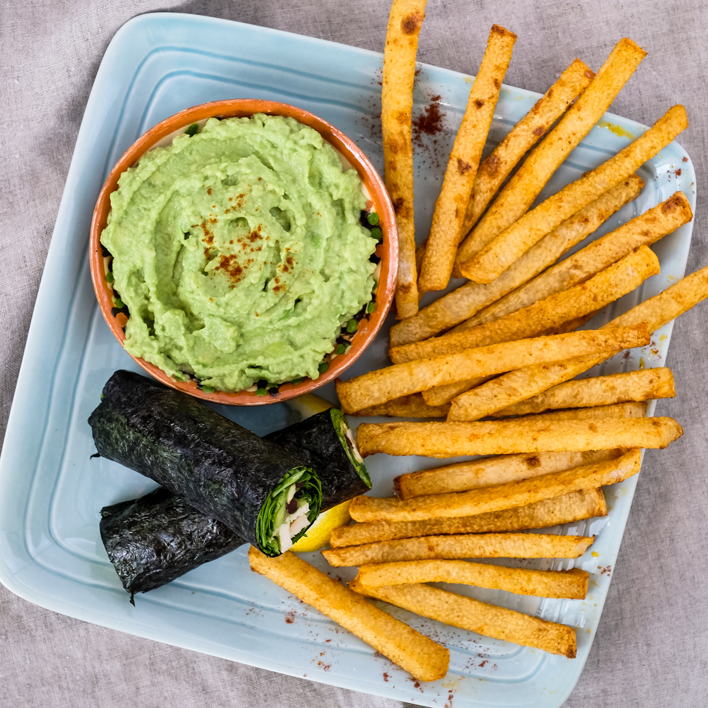Chicken nori rolls served with an avocado dipping sauce and jicama fries