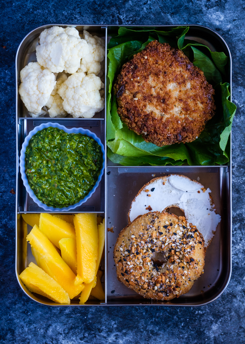 The Alaskan salmon cakes served in a lunch box.