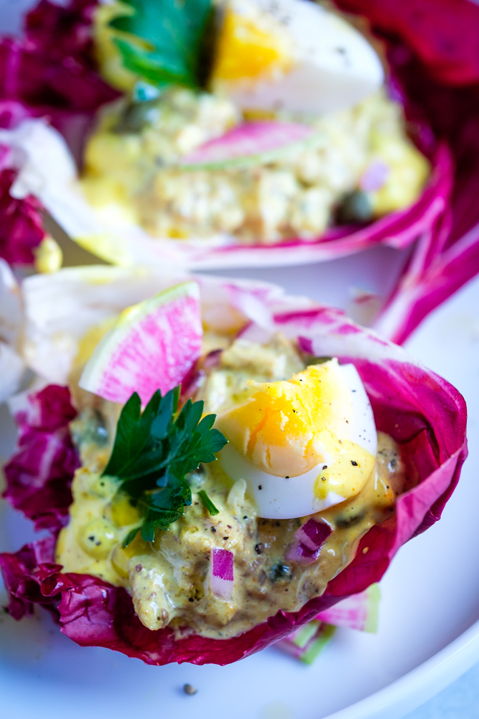 Curried Sardines in Radicchio Cups. They look delicious.