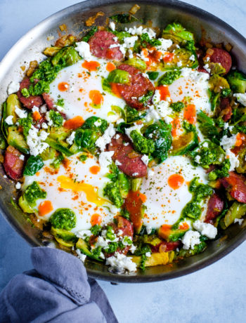 Green Shakshouka with Brussels Sprouts and Smoked Sausage