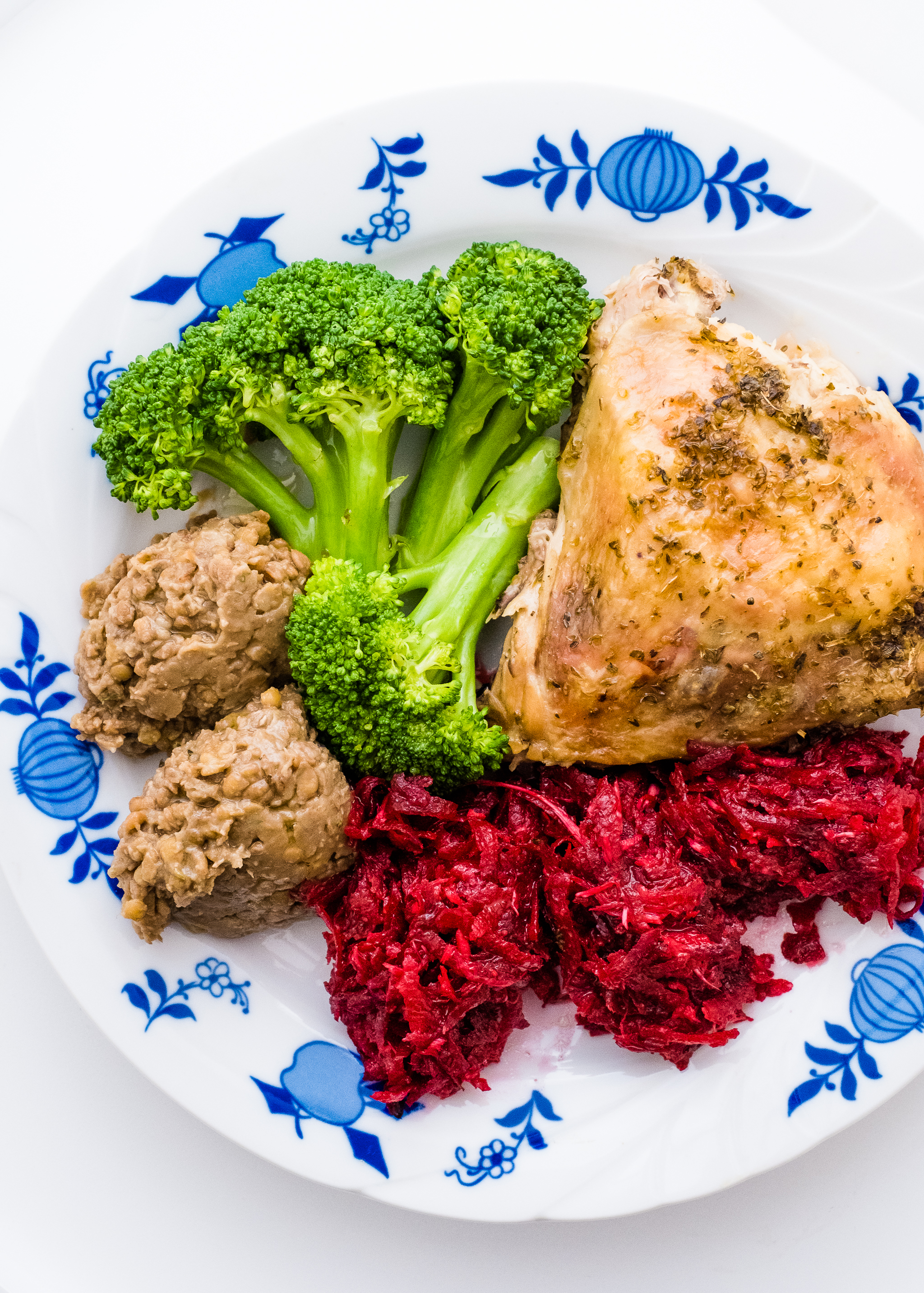 Beetroot and horseradish side salad with lentil hummus, broccoli and baked chicken