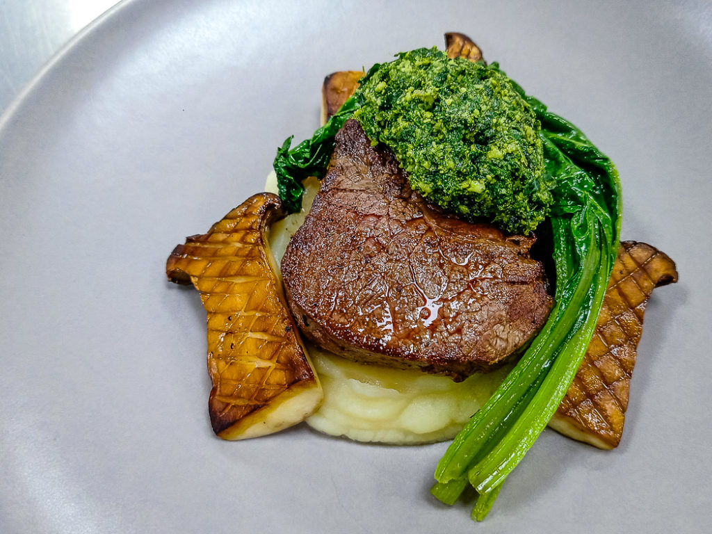 Grass-Fed Beef Tenderloin with Celeriac Puree, Chard, King Oyster Mushroom, Kale and Macadamia Pesto